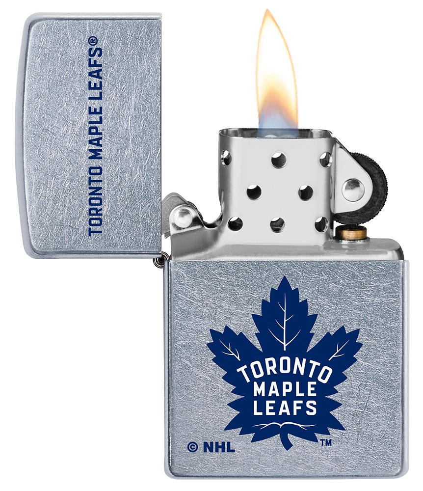 NHL Toronto Maple Leafs Street Chrome™ Windproof Lighter with its lid open and lit
