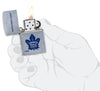 NHL Toronto Maple Leafs Street Chrome™ Windproof Lighter lit in hand