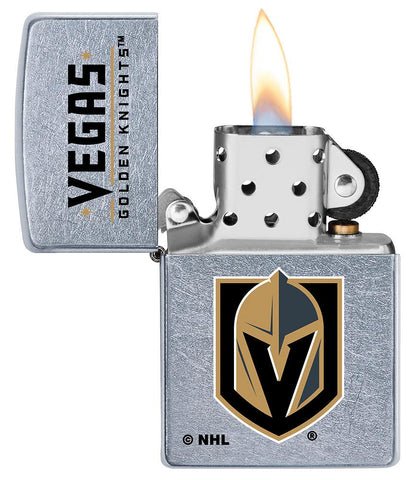 ©NHL Vegas Golden Knights Street Chrome™ Windproof Lighter with its lid open and lit