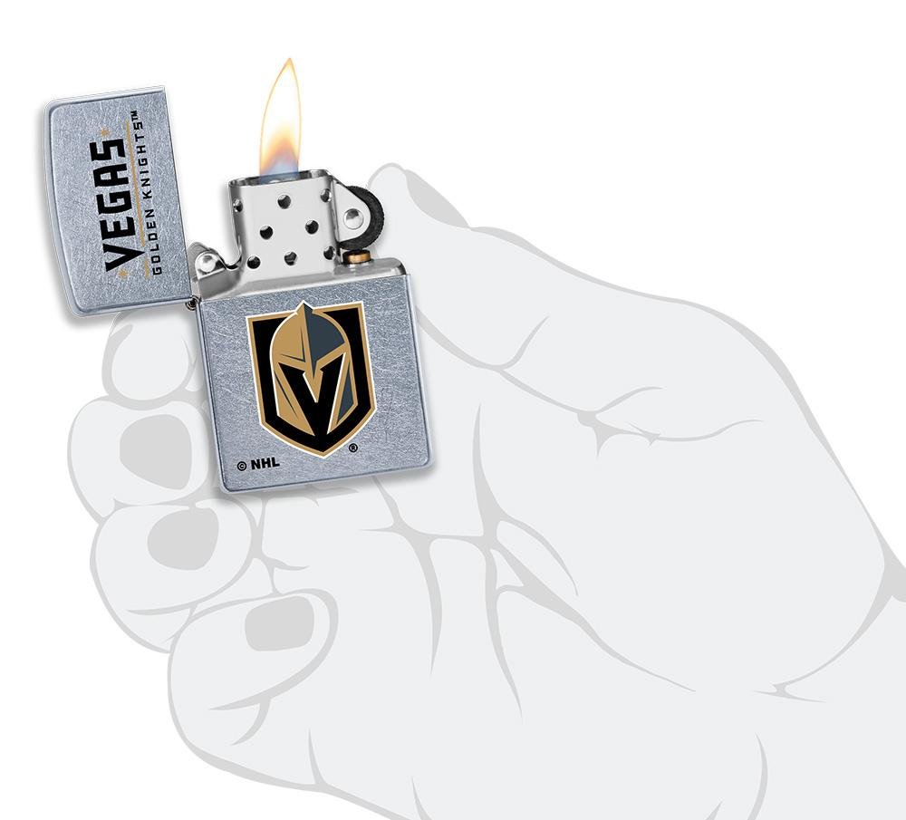 ©NHL Vegas Golden Knights Street Chrome™ Windproof Lighter lit in hand