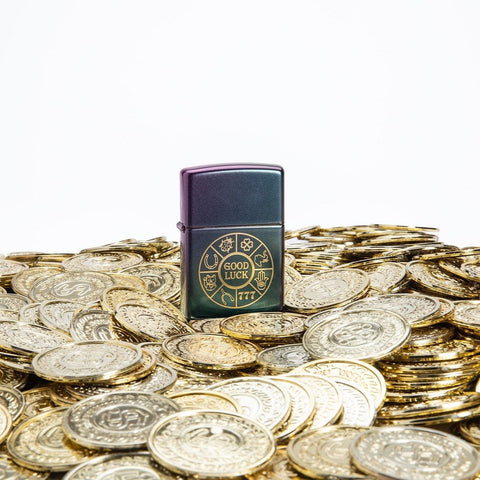 Lifestyle image of Lucky Symbols Design Iridescent Windproof Lighter standing on a bed of golden coins.