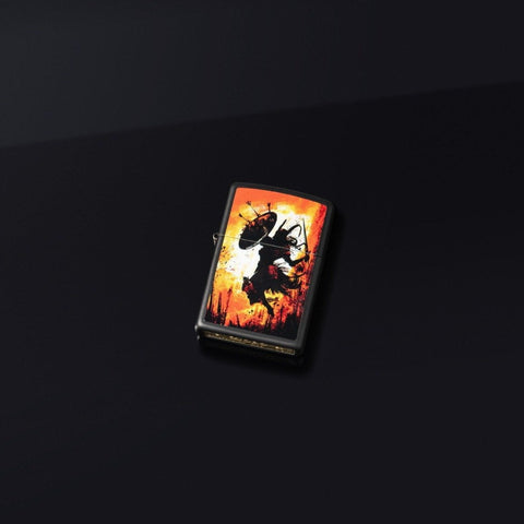 Lifestyle image of Warrior Design Black Matte Windproof Lighter laying on a black surface