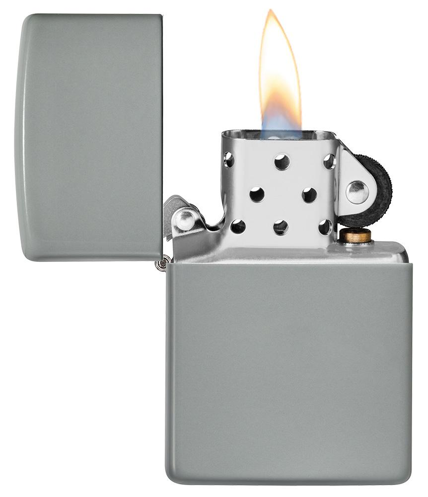 Flat Grey Windproof Lighter with its lid open and lit