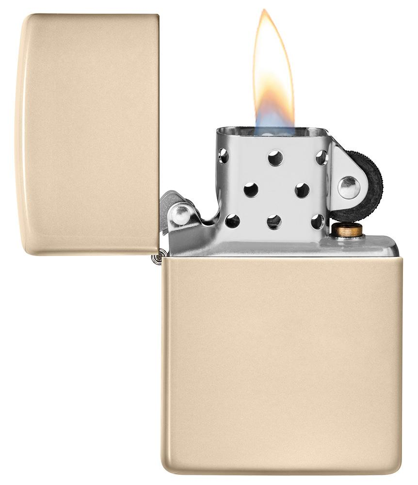 Classic Flat Sand Windproof Lighter with its lid open and lit