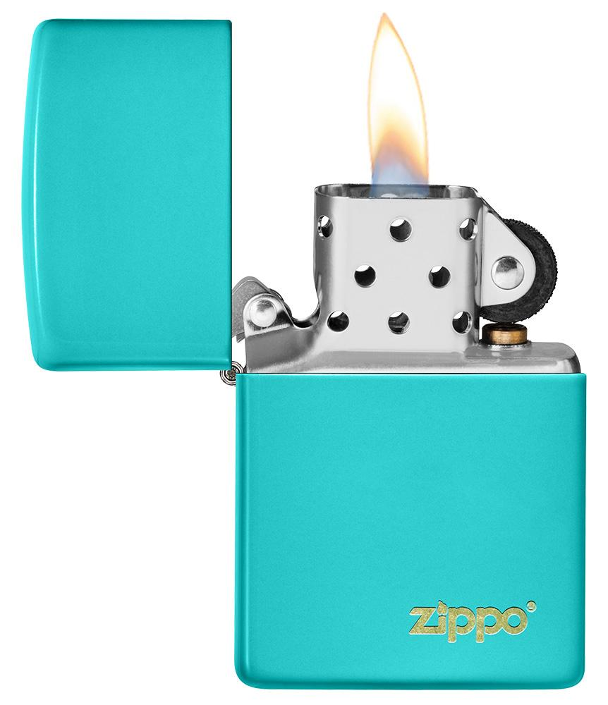 Classic Flat Turquoise Zippo Logo Windproof Lighter with its lid open and lit