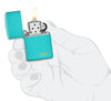 Classic Flat Turquoise Zippo Logo Windproof Lighter lit in hand