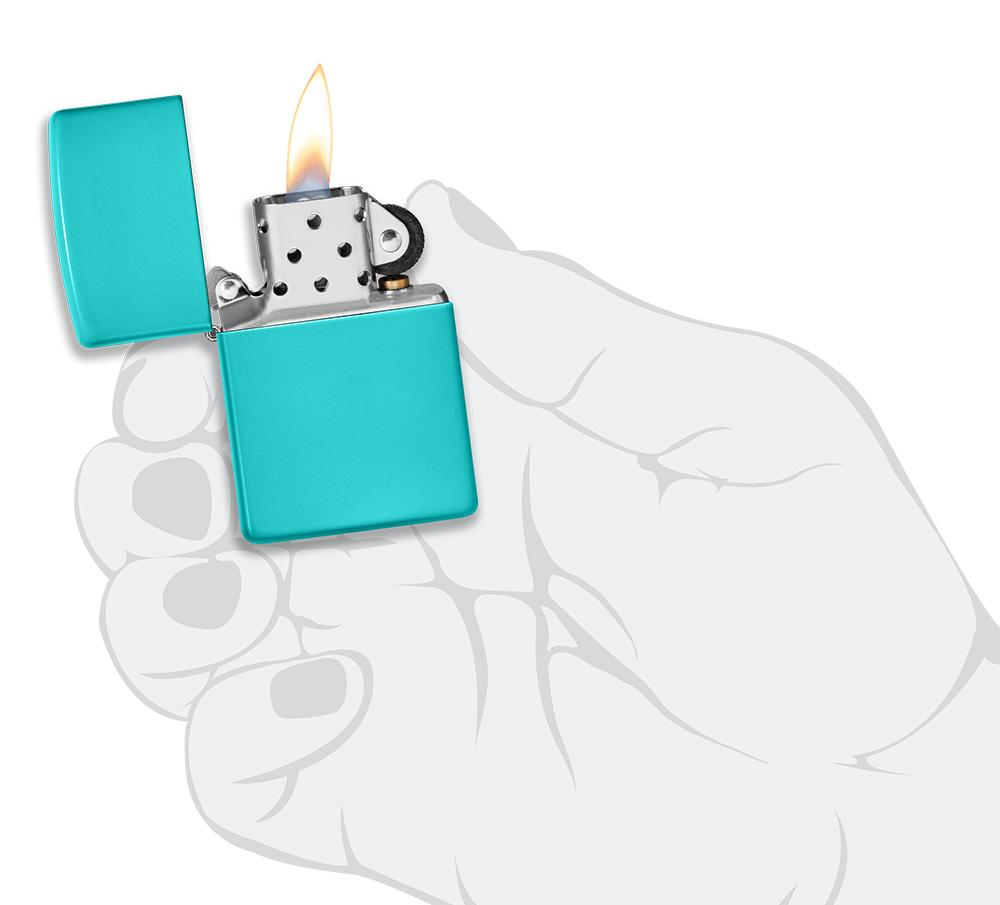 Classic Flat Turquoise Windproof Lighter lit in hand