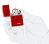 Classic Metallic Red Matte Zippo Logo Windproof Lighter lit in hand