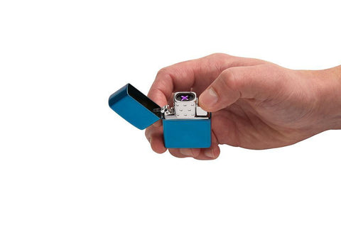 Arc Lighter Insert lit in hand, showing the double arc