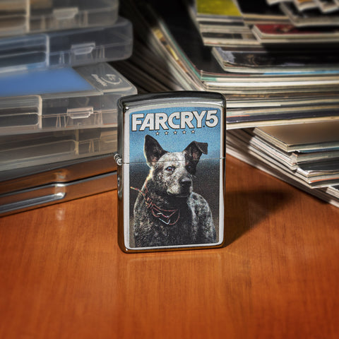 Front of Far Cry 5 Boomer lighter standing on a wooden desk with video games and magazines
