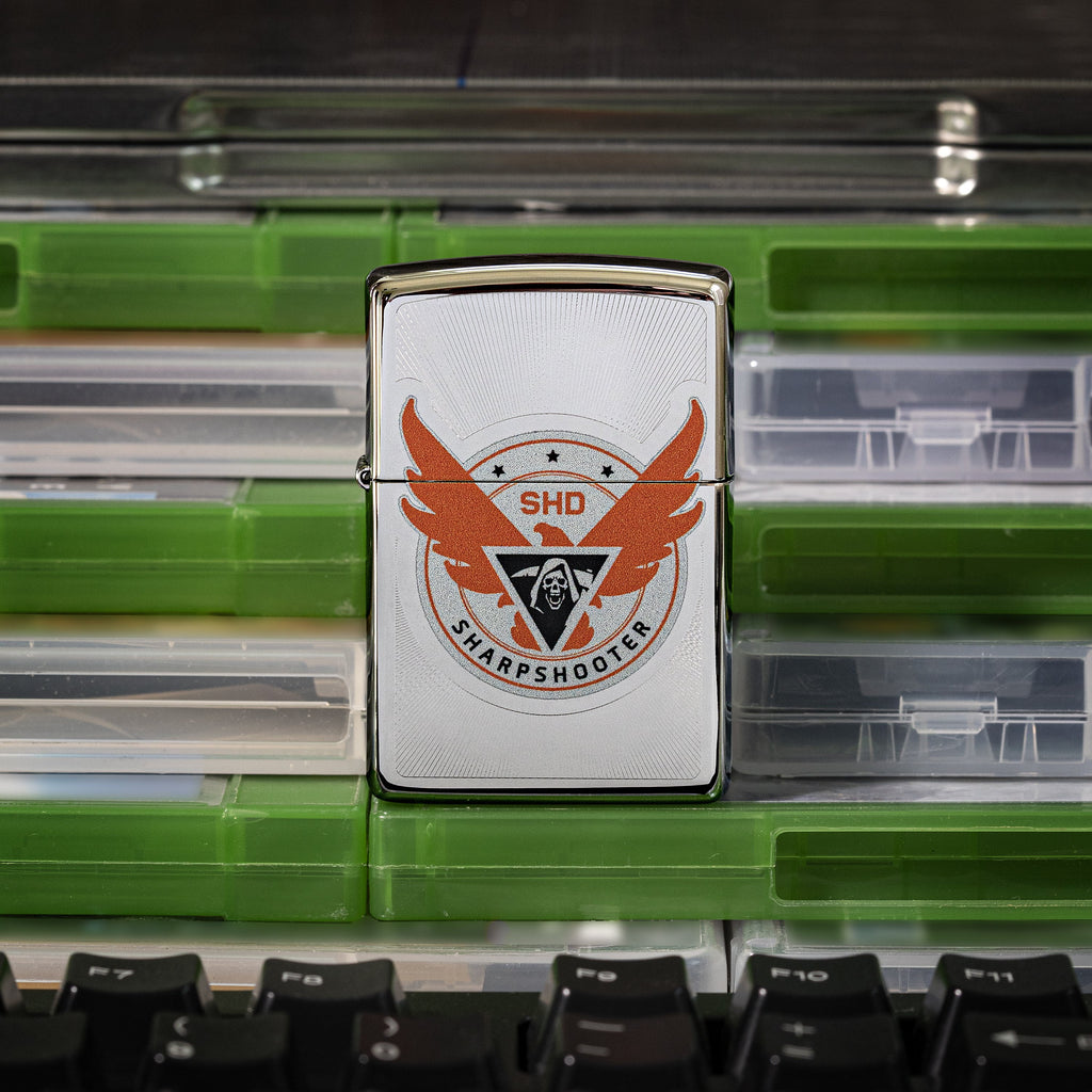 Tom Clancy's The Division 2 SHD Logo lighter front view of lighter standing on video game cases