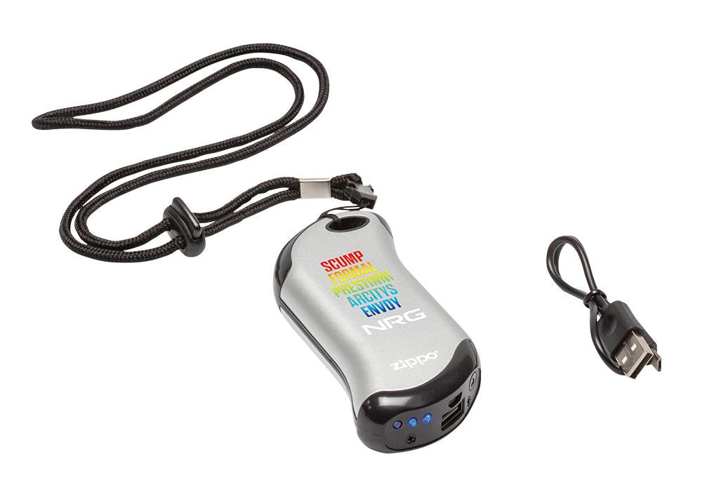 Silver NRG Chicago Huntsman Team: HeatBank® 9s Rechargeable Hand Warmer laying showing the included lanyard and power cable