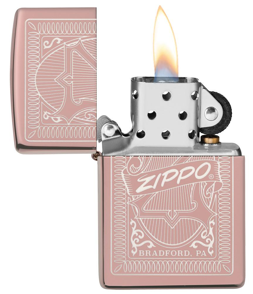 Reimagine Zippo High Polish Rose Gold Windproof Lighter with its lid open and lit