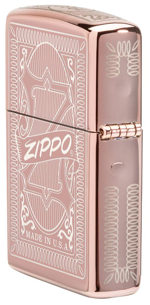 Reimagine Zippo High Polish Rose Gold Windproof Lighter standing at an angle showing the back and hinge side of the lighter design