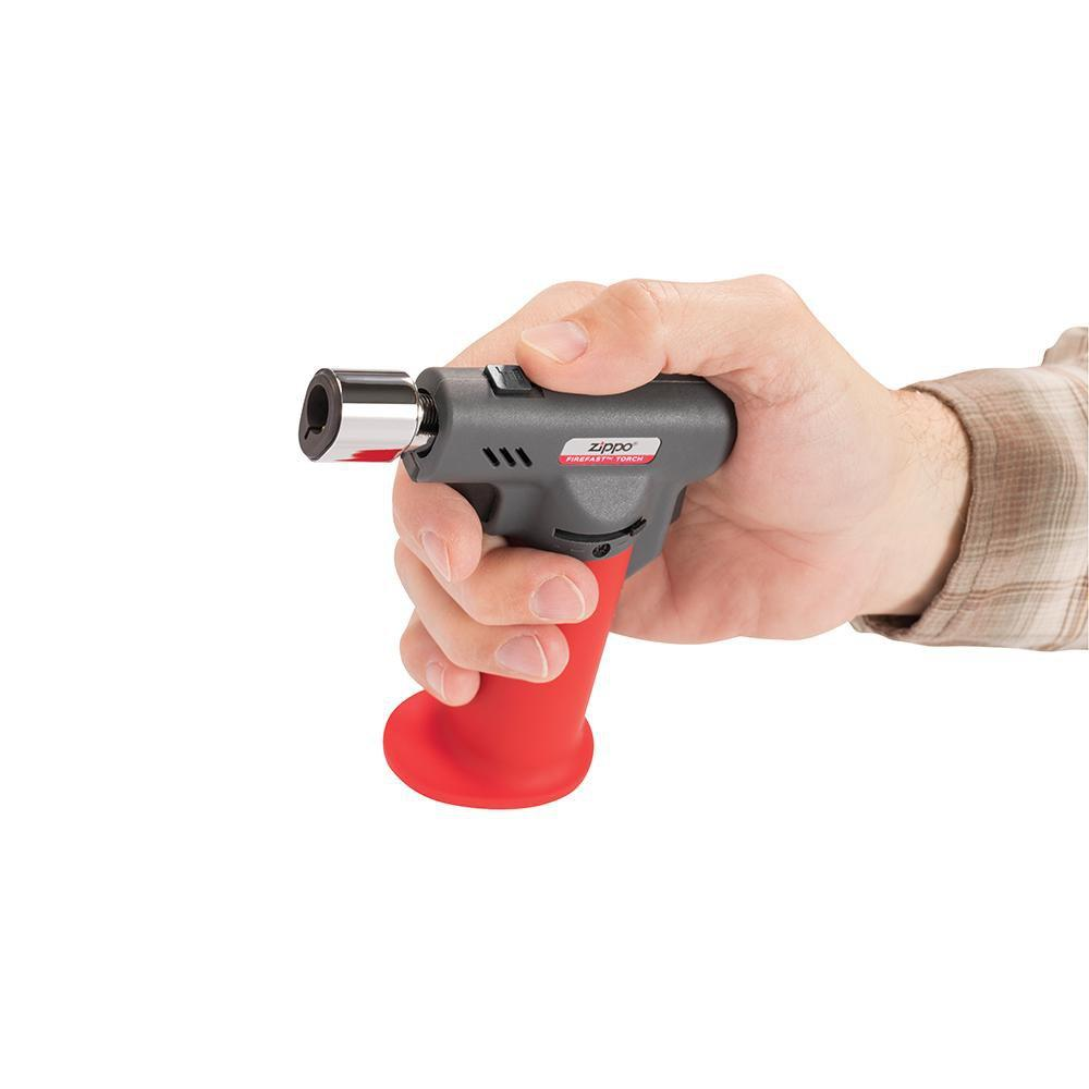 FireFast™ Torch in hand, showing the switch that allows you to switch between a soft yellow or blue flame torch
