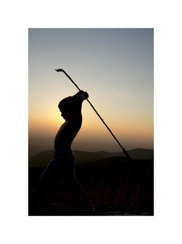 Tribal Warrior Boy at Sunset Photograph - Silhouette in Mountains