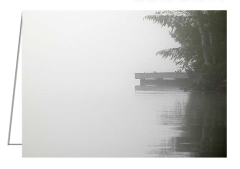 Cottage dock in the misty morning sunrise on Lake Joseph in the Muskokas.