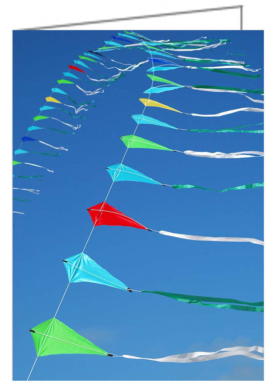 Greeting card showing a string of kites against a blue sky.