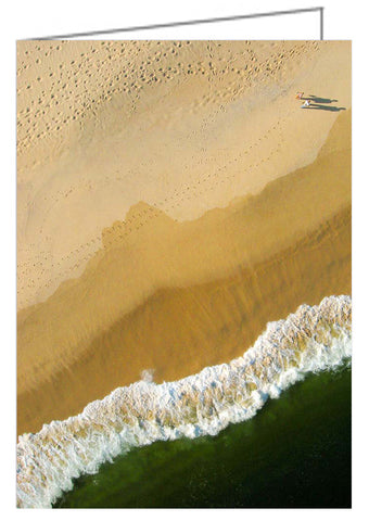 Greeting Card - A straight down aerial photograph showing the wet and dry contour lines of a beach and the surf and a couple with long shadows walking along the shoreline.