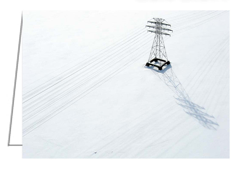 A photo greeting card of hydro lines in winter. Aerial view looking down on hydro lines and hydro tower crossing the ice and snow-covered Ottawa River at Chaudiere Falls.