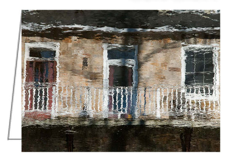 Photo greeting card - Reflections of townhouse doors and brick wall in a stream running through Perth, Ontario.