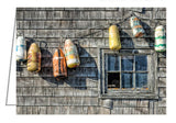 A photo greeting card. Buoys on a Wall, Peggy's Cove.