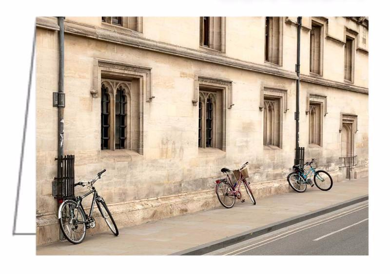 A photo greeting card of bicycles leaning against a wall along a street in Oxford, UK.