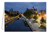 City of Ottawa from the Mackenzie Bridge. On one side the calmness of the Rideau Canal, on the other side the busy traffic of Colonel By Drive and Sussex Drive. National Arts Centre on the left, Parliament Buildings and the Chateau Laurier Hotel.