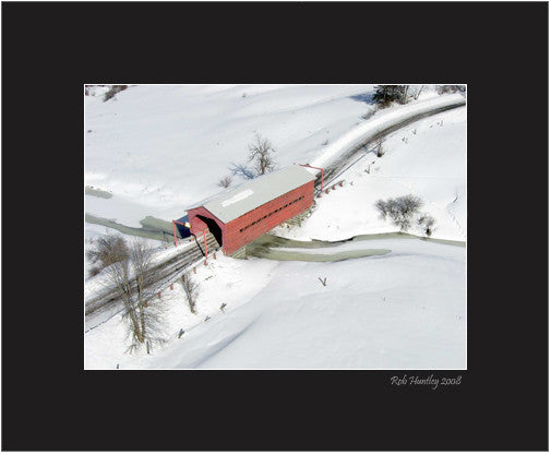 Matted Print - A red covered bridge in winter.