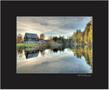 Matted Print - This is a landscape photograph of an old rustic barn alongside a mill pond in the Ottawa Valley.