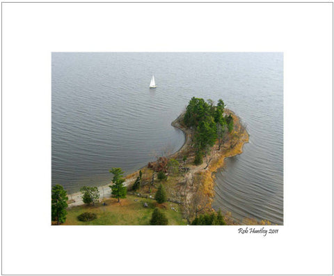 Matted Print - A sailboat sailing around Pinhey's Point, Ontario