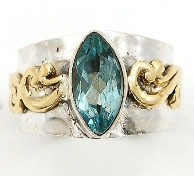 """WONDER"" gorgeous aquamarine set in wide solid sterling silver with ornate brass accent. Sz 8"