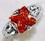 """Ravished""  2 carat orange fire sapphire (lab) set in solid sterling silver with white topaz accents"
