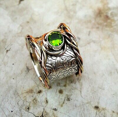 "SOLD ""BRAVE"" beautiful peridot set in wide handstamped sterling silver band with wrapped copper accent. Sz 8.5"
