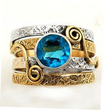 """New Song"" ring blue topaz set in solid sterling silver with brass accents"