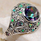 The promise 2 carat color changing rainbow topaz set in ornate sterling silver setting. Sz 8