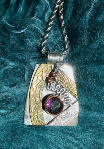"""WATCH and SEE"" Unique one-of-a-kind pendant set with a 2 1/2 carat Mystic topaz in solid sterling silver with ornate brass and copper accents. On a gorgeous silver rope chain."