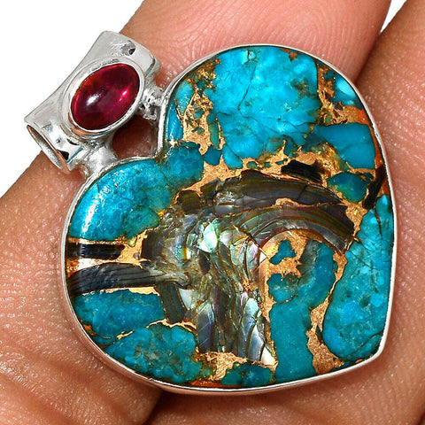 Blue copper turquoise pendant with garnet accent  set in solid sterling  silver with chain