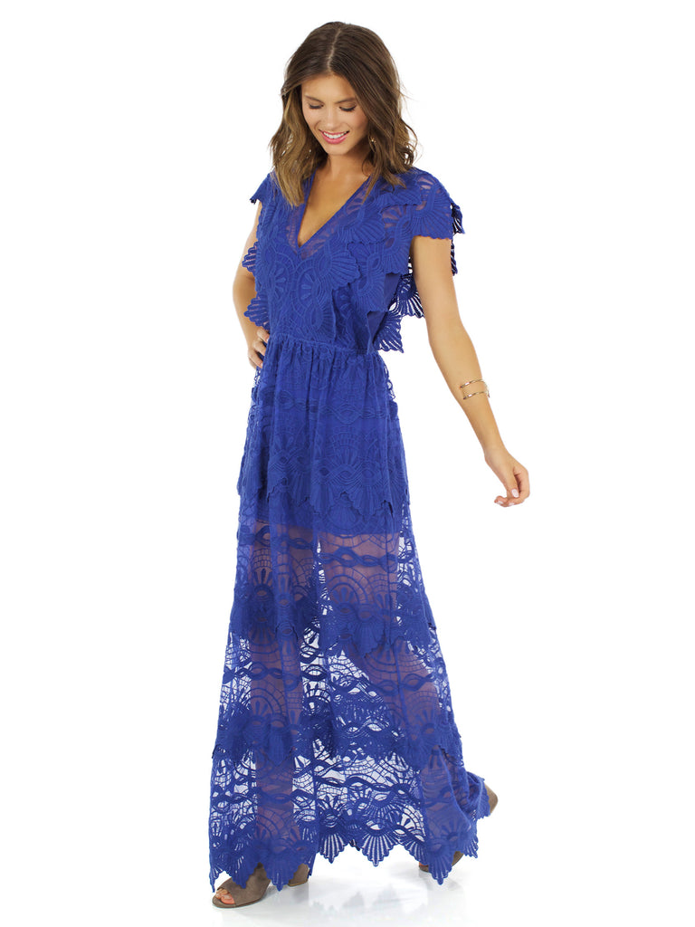 Woman wearing a dress rental from Nightcap Clothing called Samba Gown