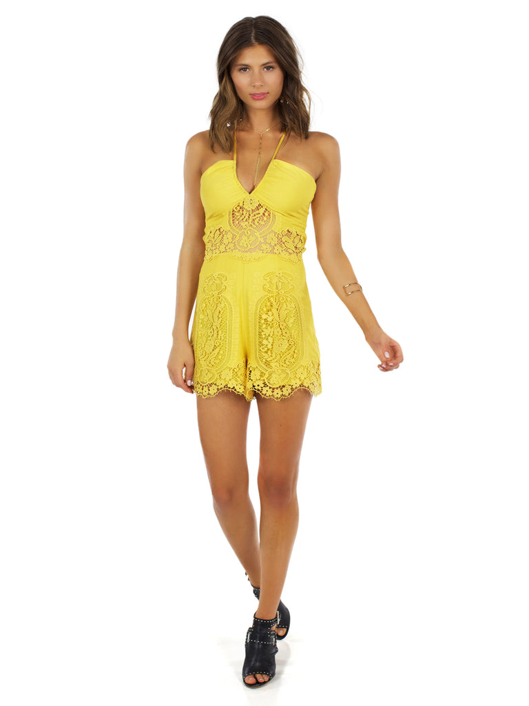 Woman wearing a romper rental from Nightcap Clothing called Mayan Lace Gown