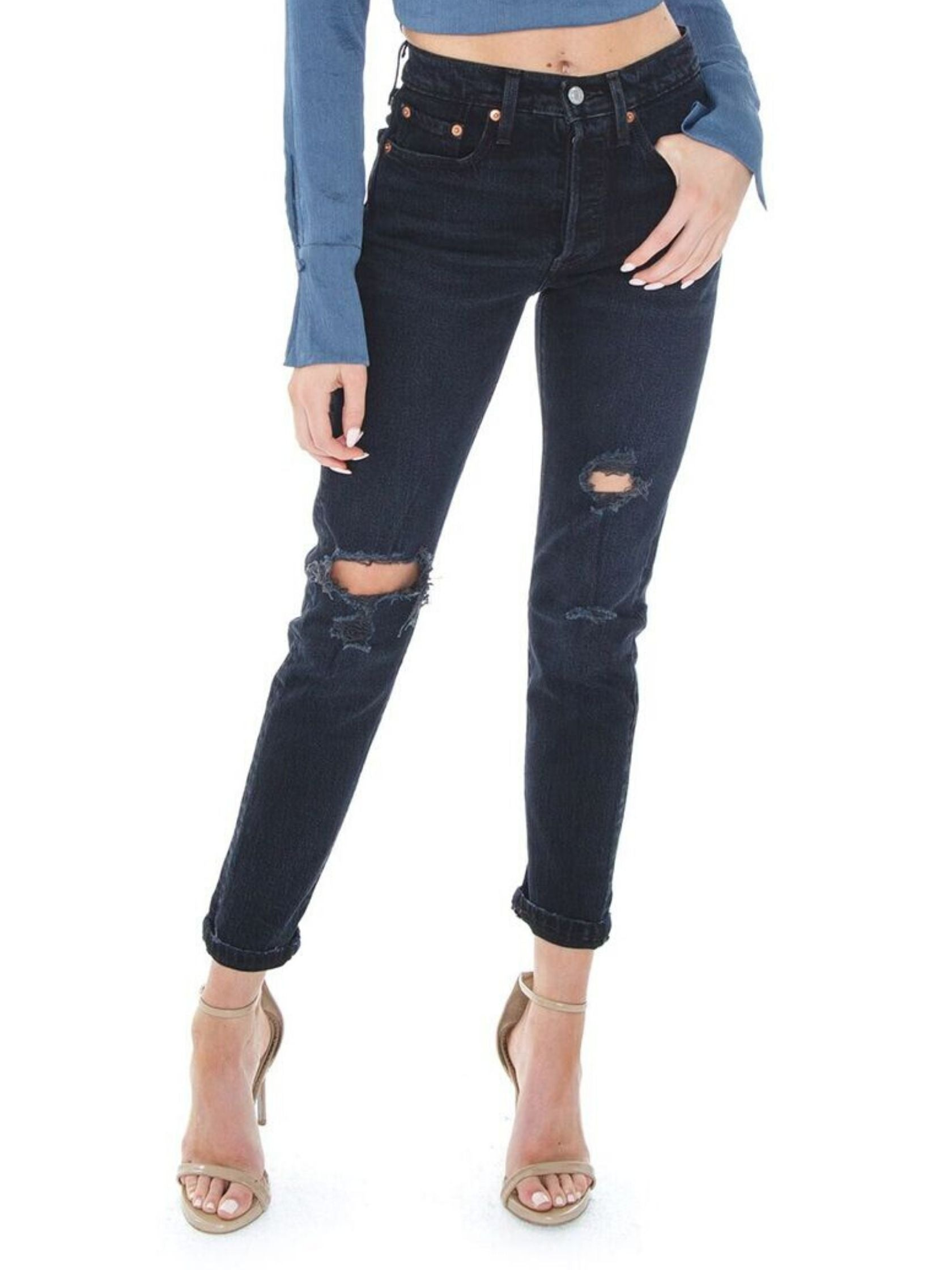Woman wearing a denim rental from Levis called 501 Skinny