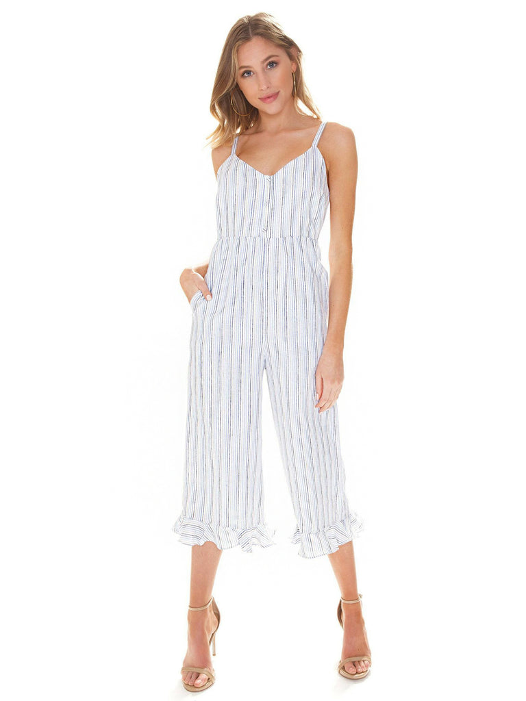Girl wearing a jumpsuit rental from Line & Dot called Alder Stripe Sweater