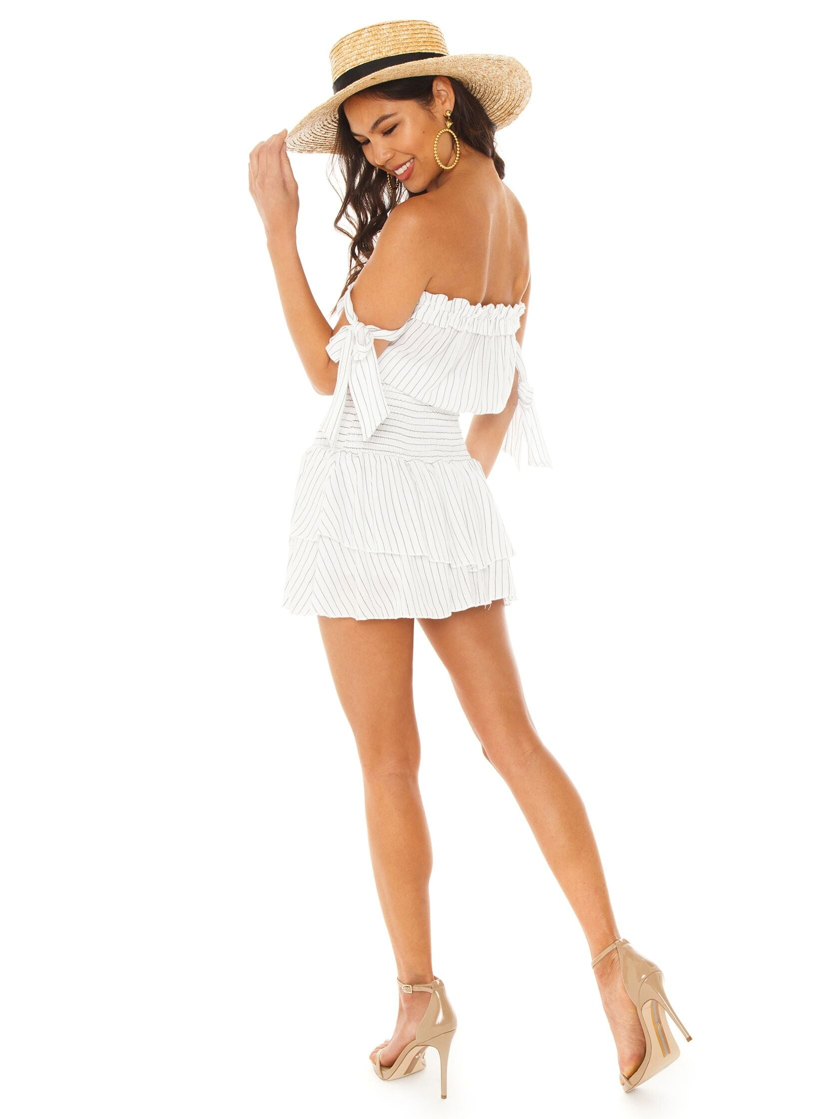Women wearing a romper rental from Blue Life called Ballerina Romper