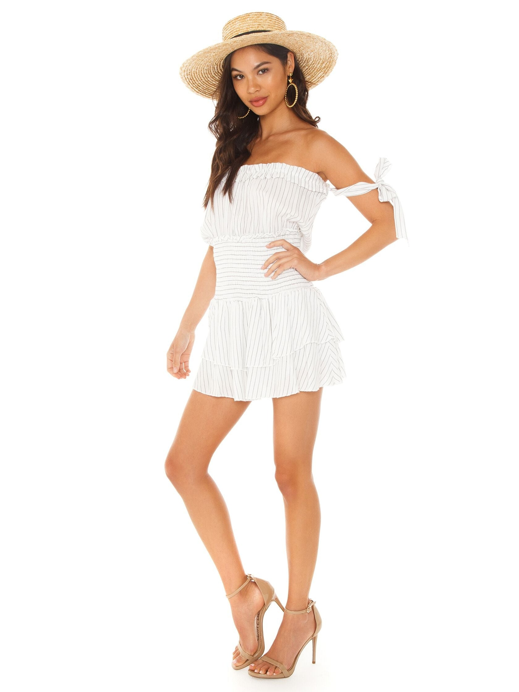 Woman wearing a romper rental from Blue Life called Ballerina Romper