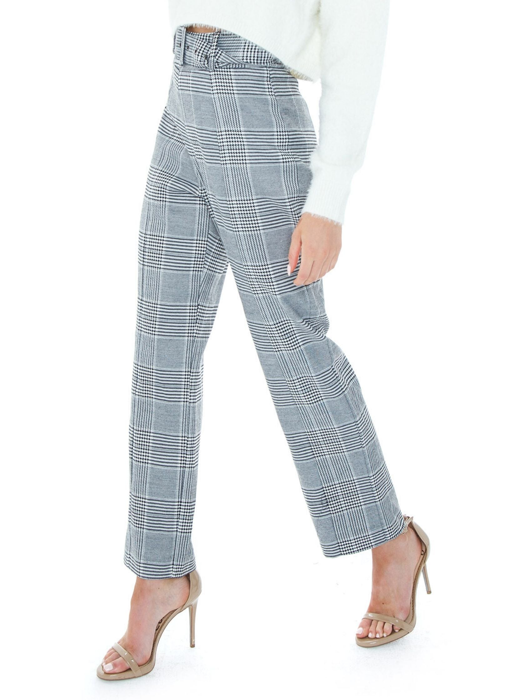 Women wearing a pants rental from BARDOT called Belted Check Pant