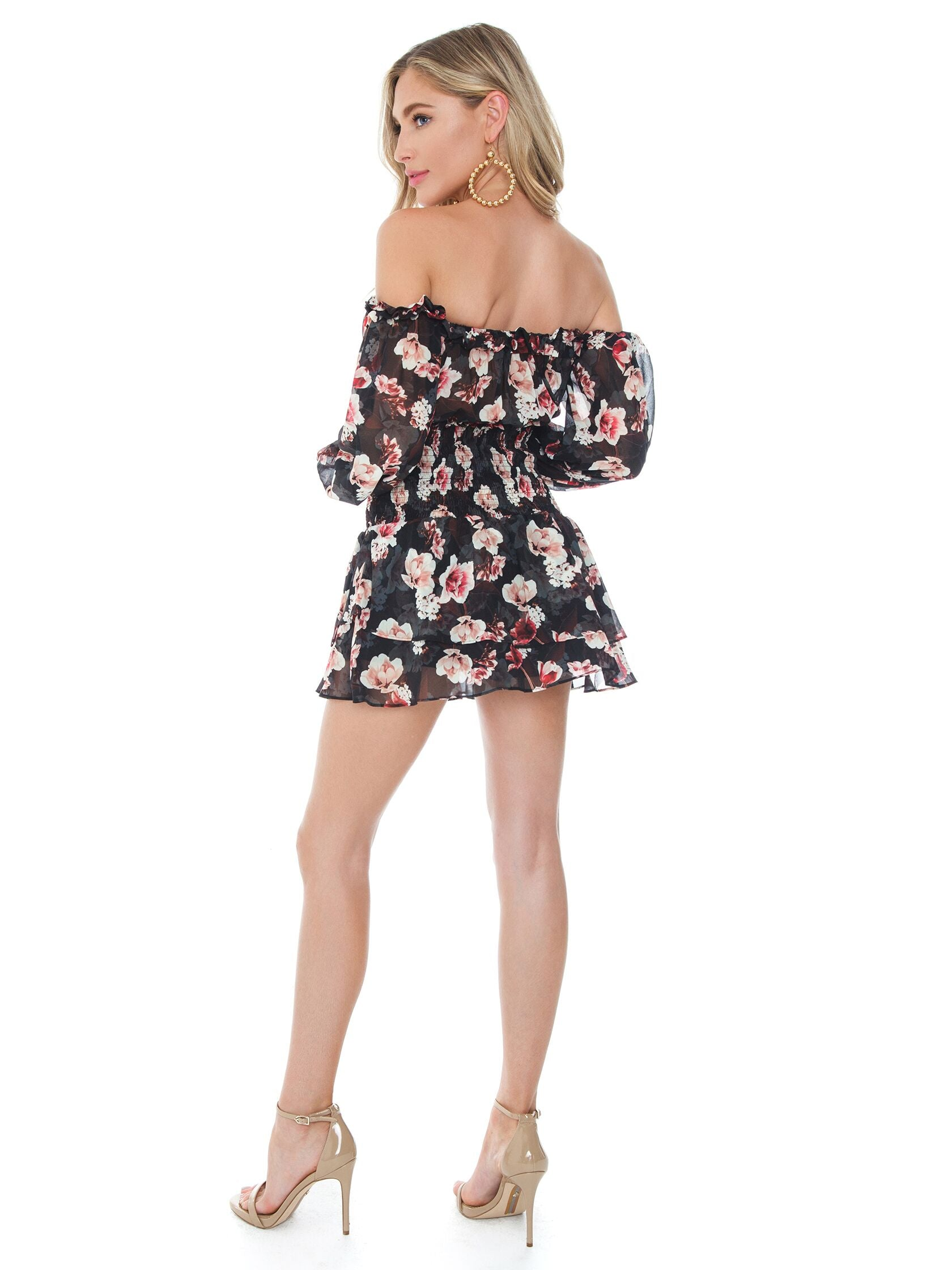 Women wearing a romper rental from Blue Life called Boho Sleeve Ballerina Romper