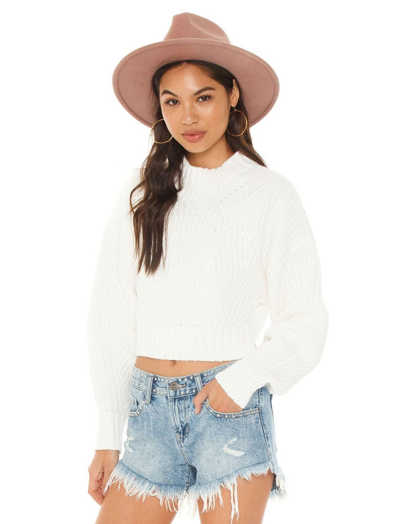Woman wearing a sweater rental from REBECCA MINKOFF called Juniper Cable Knit Sweater