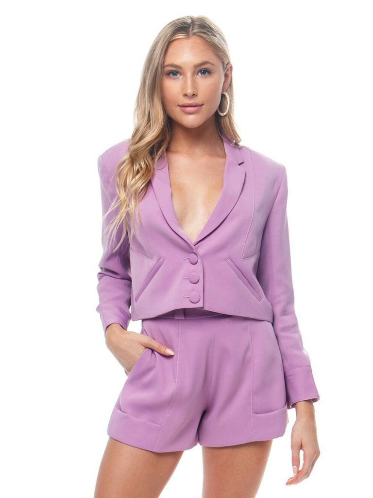 Women wearing a blazer rental from FLETCH called Adella Slip Dress