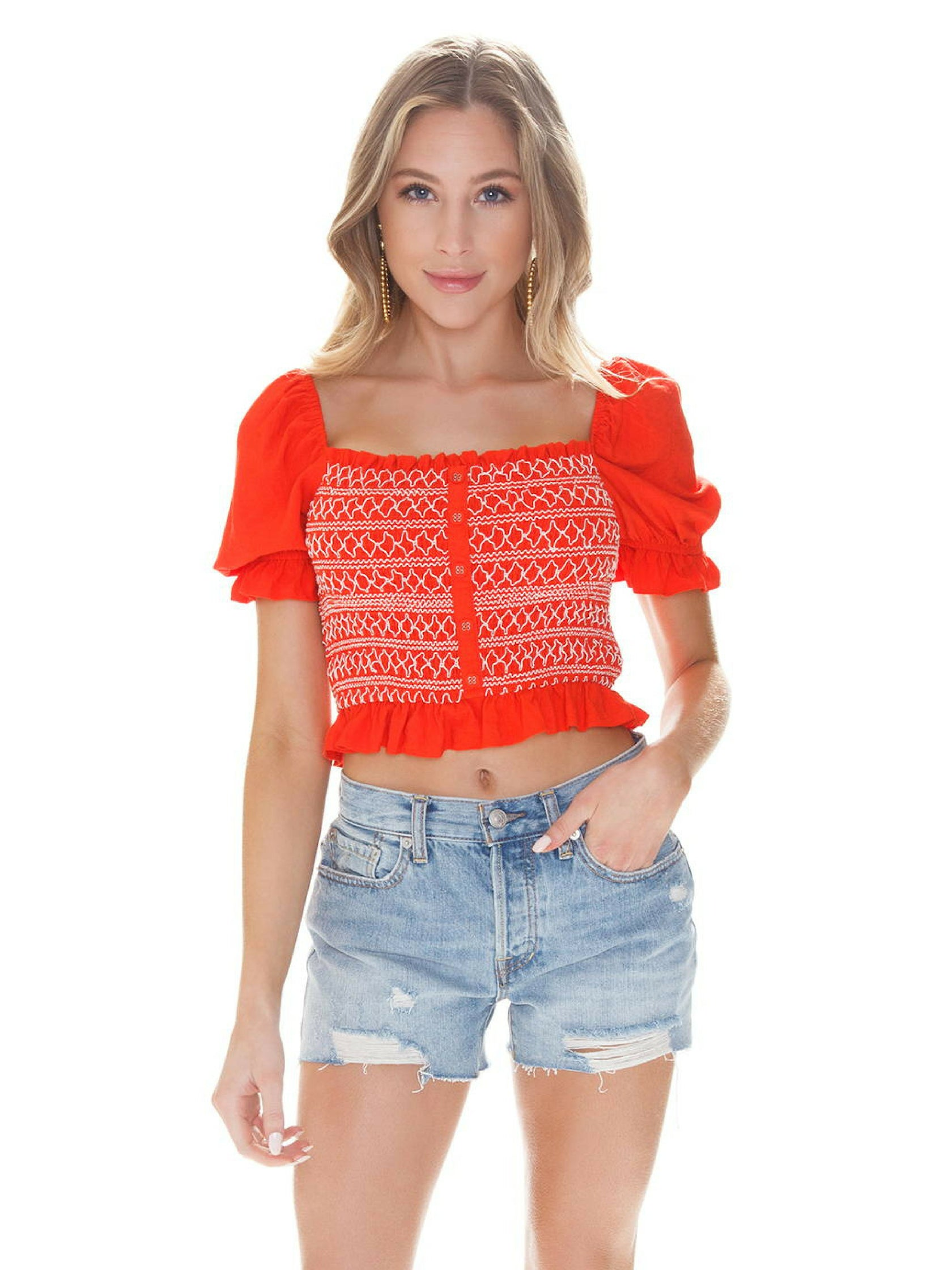 Woman wearing a top rental from LOST + WANDER called Bloody Mary Smocked Top