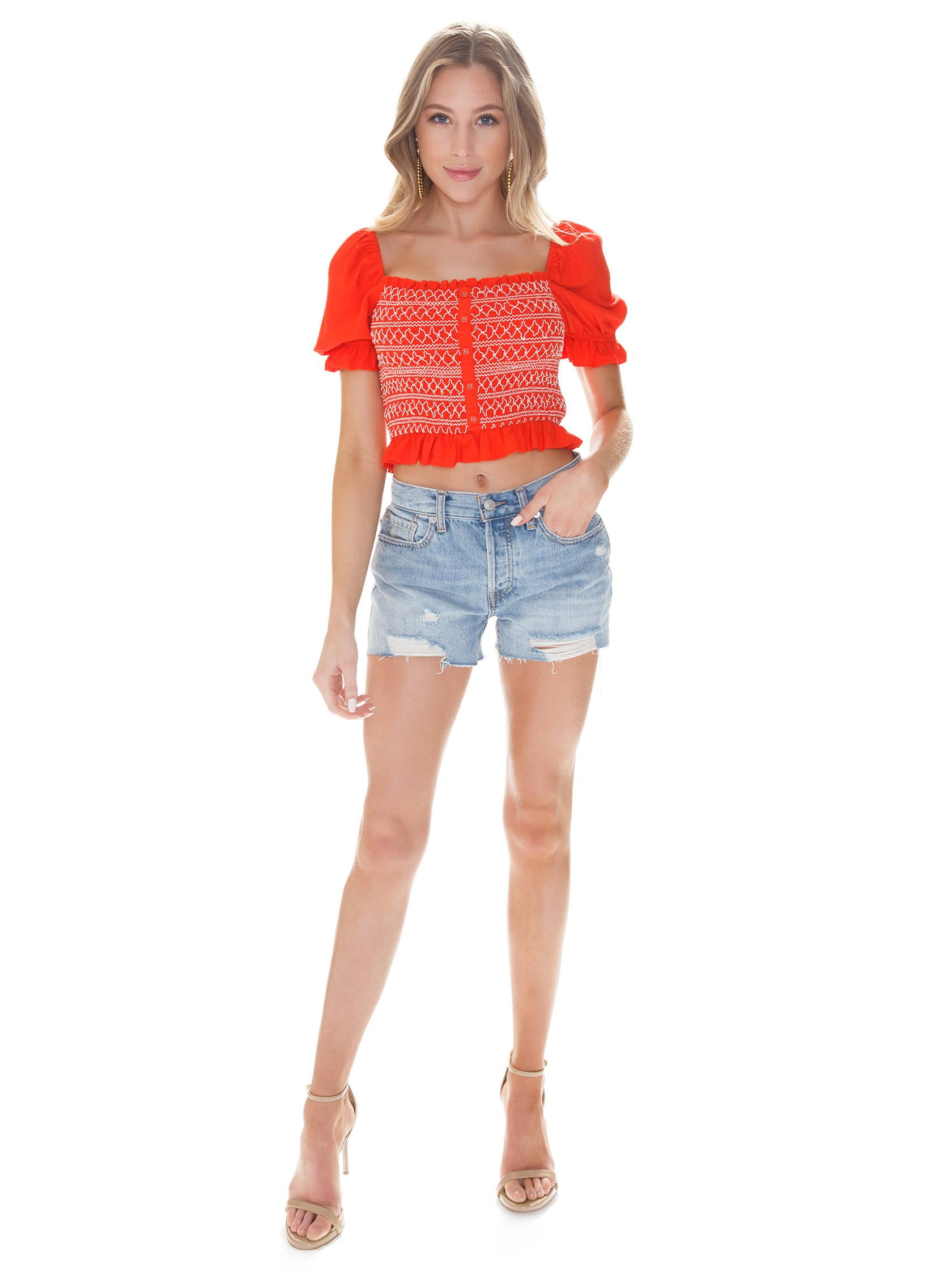 Girl wearing a top rental from LOST + WANDER called Bloody Mary Smocked Top